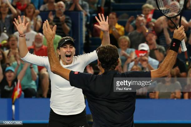 Roger Federer and Belinda Bencic of Switzerland celebrate winning the Hopman Cup against Alexander Zverev and Angelique Kerber of Germany on day...