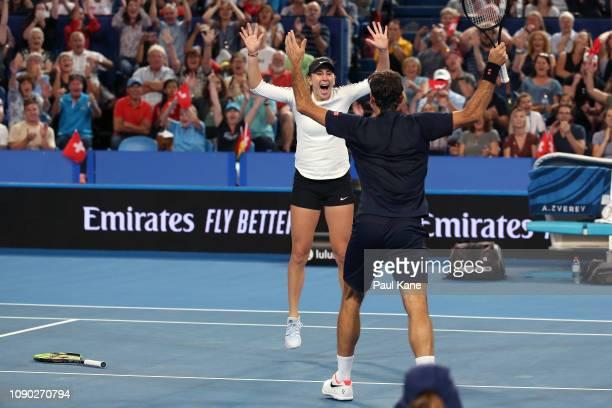 Roger Federer and Belinda Bencic of Switzerland celebrate winning the Hopman Cup final against Alexander Zverev and Angelique Kerber of Germany on...