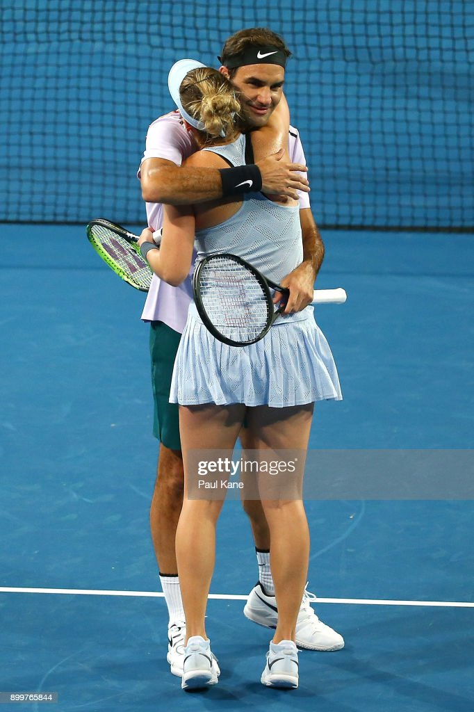 Roger Federer and Belinda Bencic of Switzerland celebrate winning the their mixed doubles 2018 Hopman Cup match against Naomi Osaka Yuichi Sugita of Japan at Perth Arena on December 30, 2017 in Perth, Australia.