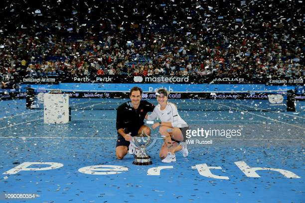 Roger Federer and Belinda Bencic of Switzerland celebrate with the Hopman Cup after defeating Angelique Kerber and Alexander Zverev of Germany in the...