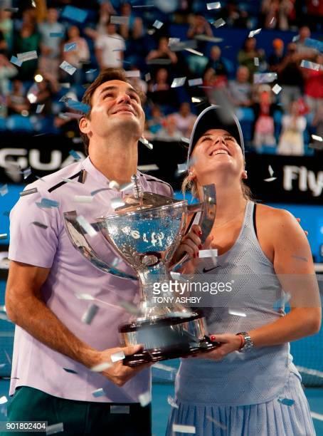 Roger Federer and Belinda Bencic of Switzerland hoist the Hopman Cup after defeating Alexander Zverev and Angelique Kerber of Germany in the mixed...