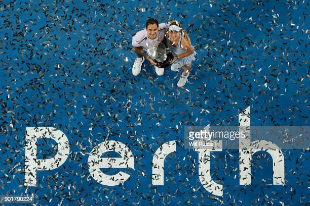 Roger Federer and Belinda Bencic of Switzerland hold the winners trophy after defeating Angelique Kerber and Alexander Zverev of Germany in the mixed...