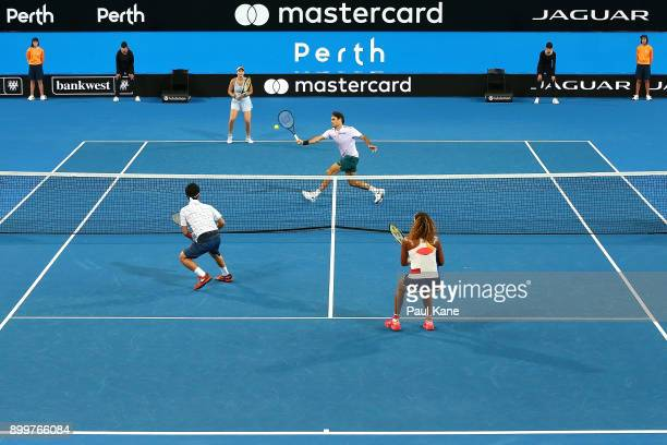 Roger Federer and Belinda Bencic of Switzerland play Naomi Osaka Yuichi Sugita of Japan in the mixed doubles 2018 Hopman Cup match at Perth Arena on...