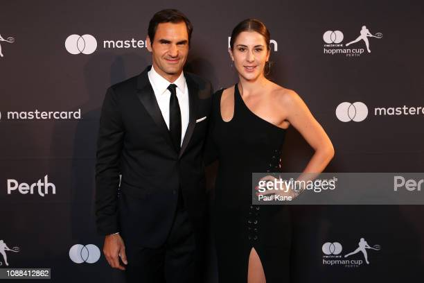Roger Federer and Belinda Bencic of Switzerland pose on the black carpet at the Hopman Cup New Years Eve Gala dinner during day three of the 2019...