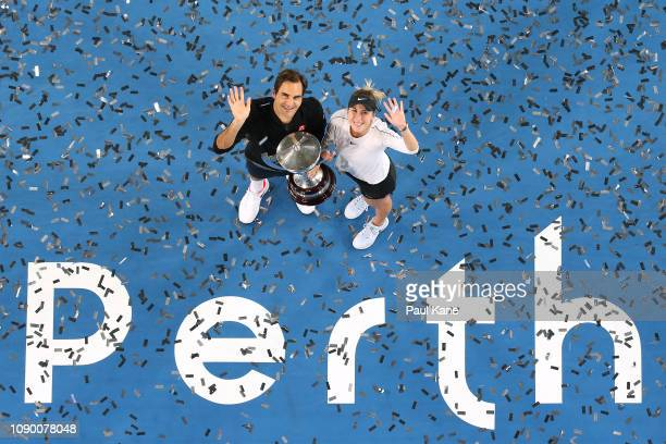 Roger Federer and Belinda Bencic of Switzerland pose with the Hopman Cup after winning the final against Alexander Zverev and Angelique Kerber of...