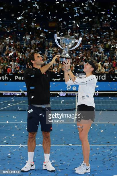 Roger Federer and Belinda Bencic of Switzerland pose with the Hopman Cup after defeating Angelique Kerber and Alexander Zverev of Germany in the...