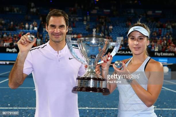 Roger Federer and Belinda Bencic of Switzerland pose with the Hopman Cup trophy and diamond encrusted white gold tennis balls after defeating...