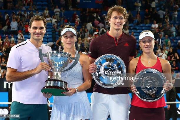 Roger Federer and Belinda Bencic of Switzerland pose with the Hopman Cup trophy together with Alexander Zverev and Angelique Kerber of Germany with...