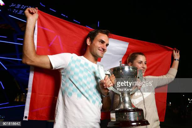 Roger Federer and Belinda Bencic of Switzerland pose with the Hopman Cup trophy after defeating Alexander Zverev and Angelique Kerber of Germany in...