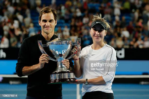 Roger Federer and Belinda Bencic of Switzerland with the Hopman Cup after defeating Angelique Kerber and Alexander Zverev of Germany in the final...