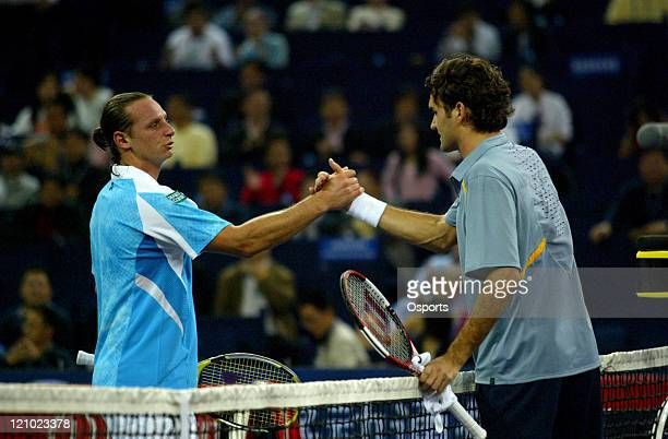 Roger Federer and David Nalbandian shake hands after their first round match at the Tennis Masters Cup in Shanghai China on November 12 2006 Federer...