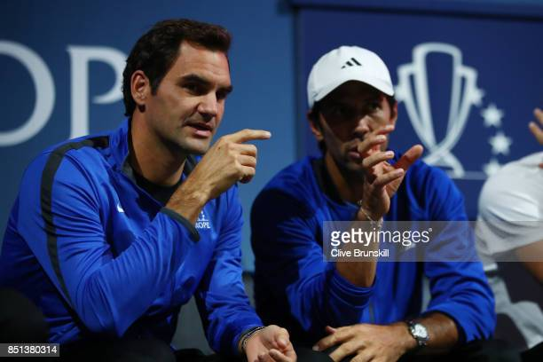 Roger Federer and Fernando Verdasco Team Europe talk as they sit on the players bench on the first day of the Laver Cup on September 22 2017 in...