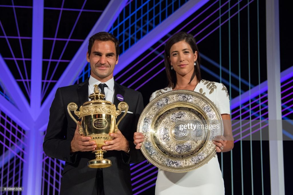 Roger Federer and Garbine Muguruza pose with their trophies at the Wimbledon Winners Dinner at The Guildhall on July 16, 2017 in London, England.
