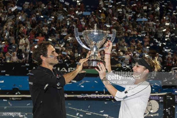 TOPSHOT Roger Federer and his mixed doubles partner Belinda Bencic of Switzerland with the Hopman Cup after defeating runnersup Alexander Zverev and...