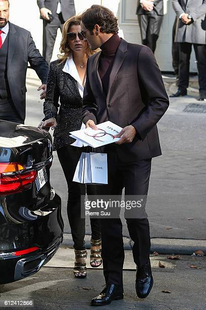 Roger Federer and his wife Mirka Federer leave the Chanel show as part of the Paris Fashion Week Womenswear Spring/Summer 2017 on October 4 2016 in...