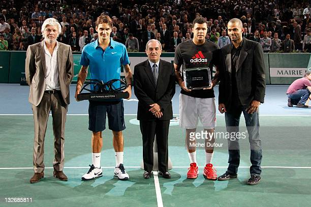 Roger Federer and Jo-Wilfried Tsonga pose with their trophies and Jean Francois Caujolle , Jean Gachassin and Tony Parker during 'BNP Paribas' Tennis...