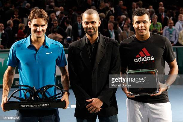 Roger Federer and Jo-Wilfried Tsonga pose with their trophies and Tony Parker at the BNP Paribas' Tennis Masters Final in Bercy at Palais Omnisports...