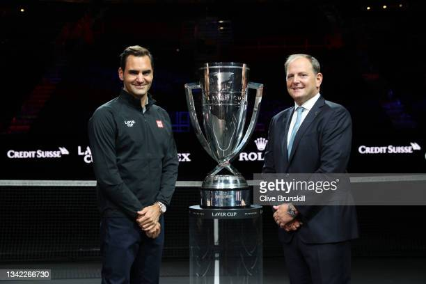 Roger Federer and Laver Cup Chairman Tony Godsick pose for a photograph with the Laver Cup Trophy after taking part in a live TV interview on CNBC at...