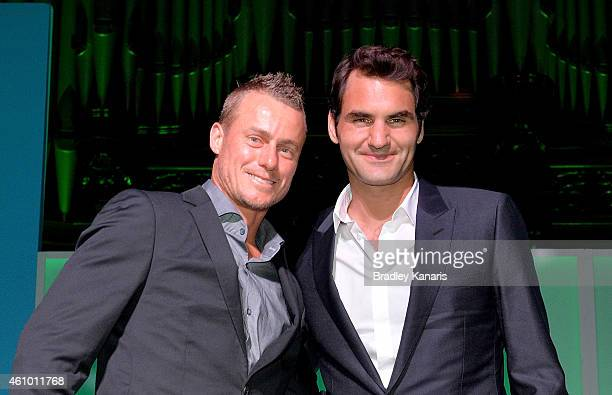 Roger Federer and Lleyton Hewitt pose for a photo after speaking at the A Summer Night with the Stars of International Tennis at the Brisbane Town...