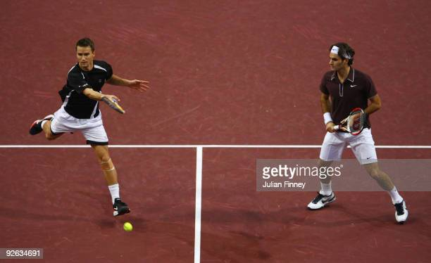 Roger Federer and Marco Chiudinelli of Switzerland in action against James Cerretani of USA and Aisam-ul-Haq Qureshi of Pakistan in the doubles...