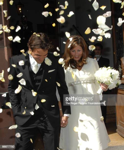 Roger Federer and Mirka Vavrinec are showered with confetti after their wedding on April 11 2009 in Basel Switzerland
