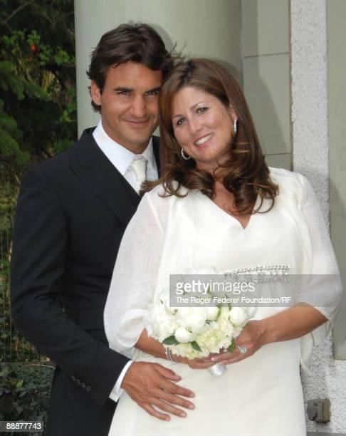 Roger Federer and Mirka Vavrinec pose after their wedding on April 11, 2009 in Basel, Switzerland.