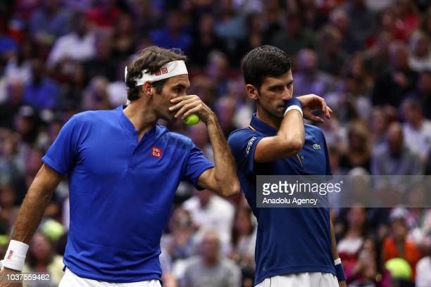 Roger Federer and Novak Djokovic of the Team Europe in action against Kevin Anderson and Jack Sock of the Team World during their Men's Doubles match...