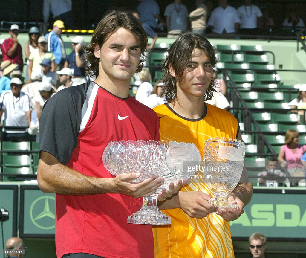 Roger Federer (SUI) and Rafael Nadal (ESP) after Federer defeated Nadal 2-6, 6-7 (4) 7-6 (5) 6-3, 6-1 in the final of the Nasdaq-100 Open at Key Biscayne, FL