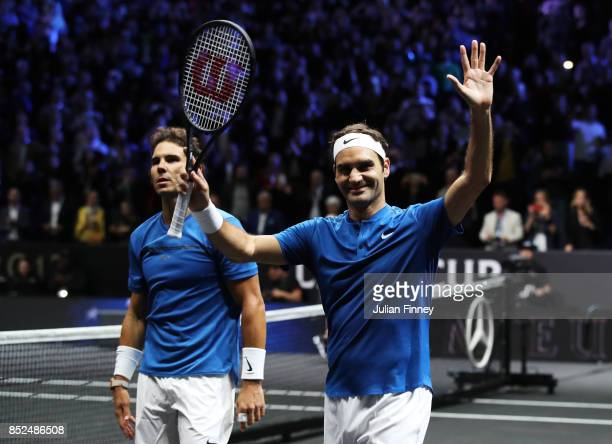 Roger Federer and Rafael Nadal of Team Europe celebrate after winning there doubles match against Jack Sock and Sam Querrey of Team World on Day 2 of...
