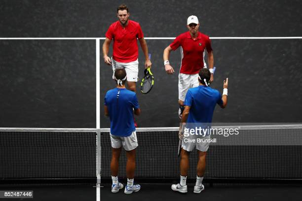 Roger Federer and Rafael Nadal of Team Europe celebrate at the net after winning there doubles match against Jack Sock and Sam Querrey of Team World...