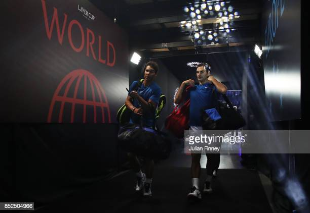 Roger Federer and Rafael Nadal of Team Europe leave after winning there doubles match against Jack Sock and Sam Querrey of Team World on Day 2 of the...