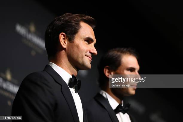 Roger Federer and Rafael Nadal of Team Europe pose for a photo on the black carpet as they arrive at HEAD Geneve for the Laver Cup Gala ahead of the...