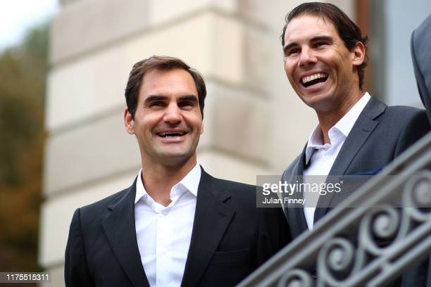 Roger Federer and Rafael Nadal of Team Europe react as they are presented to the crowd at Palais Eynard during the official welcome ceremony prior to...