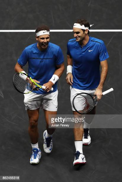 Roger Federer and Rafael Nadal of Team Europe react during there doubles match against Jack Sock and Sam Querrey of Team World on Day 2 of the Laver...