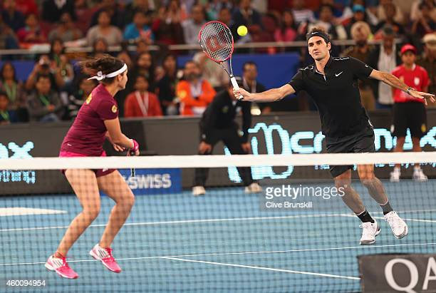 Roger Federer and Sania Mirza of the Indian Aces in action against Nick Kyrgios and Daniela Hantuchova of the Singapore Slammers during the CocaCola...