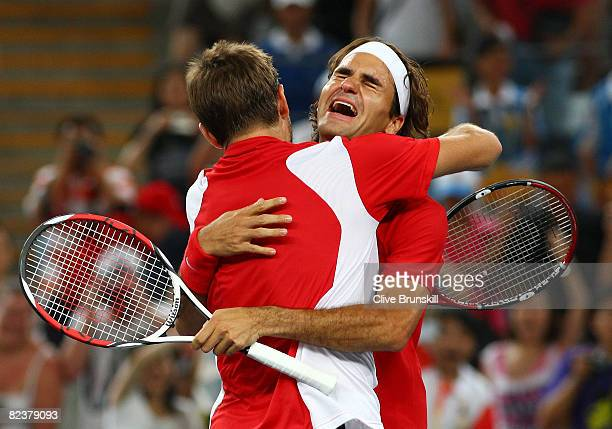 Roger Federer and Stanislas Wawrinka of Switzerland celebrate after defeating Thomas Johansson and Simon Aspelin of Sweden during the men's doubles...