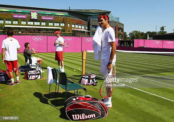 Roger Federer and Stanislas Wawrinka of Switzerland take a break during practice during previews ahead of the 2012 London Olympic Games in Olympic...