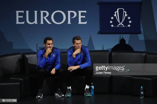 Roger Federer and Thomas Enqvist of Team Europe look on as Dominic Thiem of Team Europe plays his singles match against John Isner of Team World on...