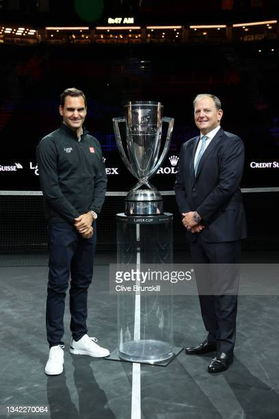 Roger Federer and Tony Godsick Laver Cup Chairman pose for a photograph with the Laver Cup Trophy after taking part in a live TV interview on CNBC at...