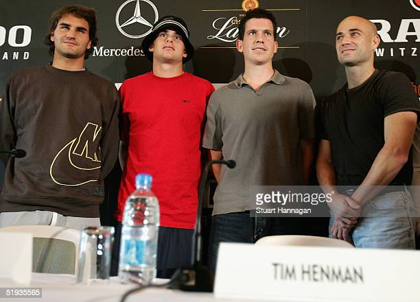 Roger Federer Andy Roddick Tim Henman and Andre Agassi pose for photos during a news conference for the Kooyong Classic which starts tommorrow at...