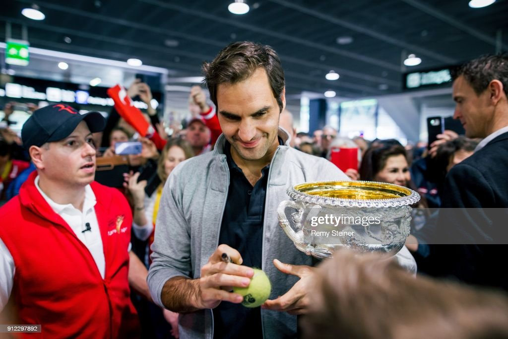 Roger Federer arrives at Airport Kloten with his trophy after winning the 2018 Australian Open Men's Singles Final on January 30, 2018 in Zurich, Switzerland.