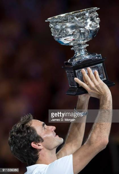 Roger Federer celebrates after winning the men's singles tournament against Marin Cilic of Croatia on day 14 of the 2018 Australian Open at Melbourne...