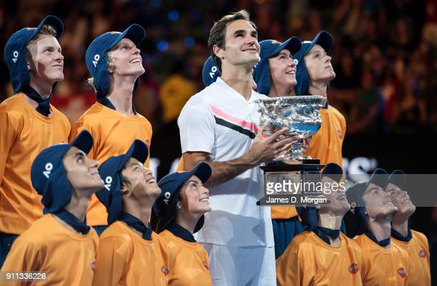 Roger Federer celebrates after winning the men's singles tournament against Marin Cilic of Croatia with the ball kids on day 14 of the 2018...