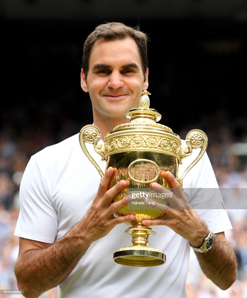 Roger Federer celebrates with the trophy after winning the Men's Final during day 13 of Wimbledon 2017 on July 16, 2017 in London, England.