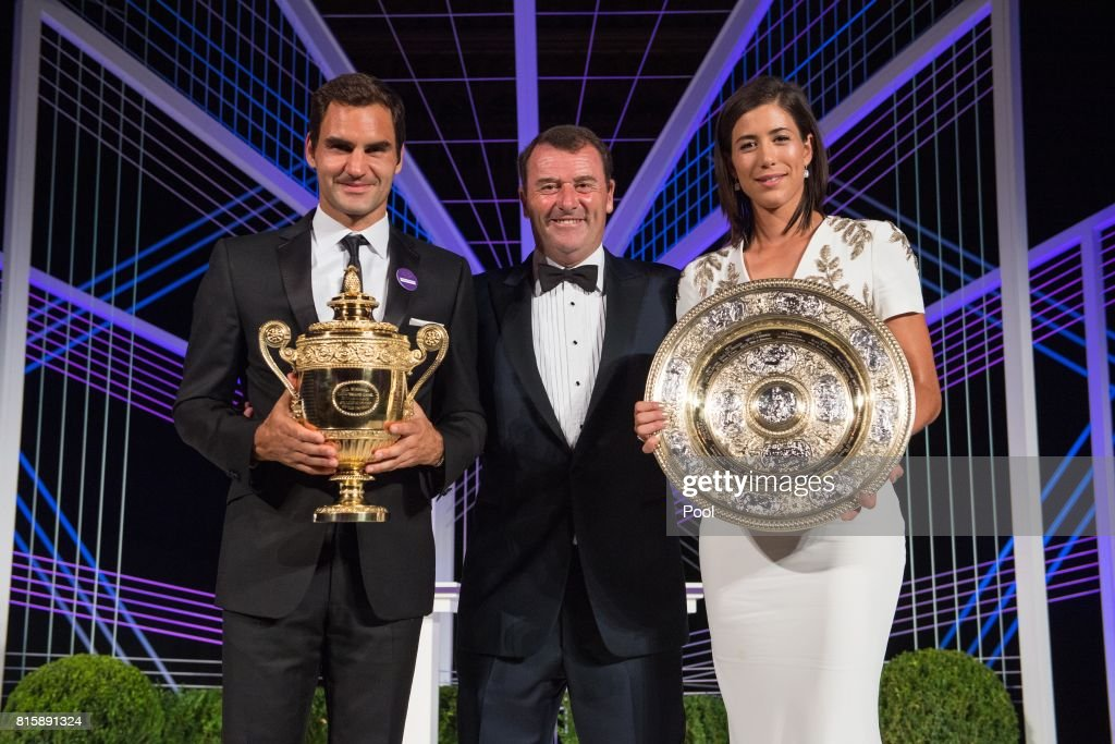 Roger Federer, Chairman of the All England Lawn Tennis Club, Philip Brook and Garbine Muguruza attend the Wimbledon Winners Dinner at The Guildhall on July 16, 2017 in London, England.
