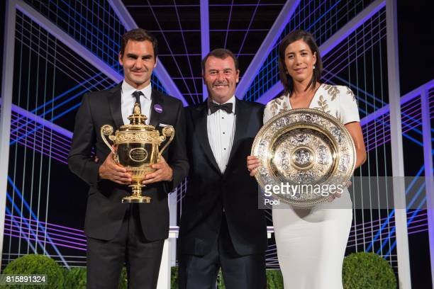Roger Federer Chairman of the All England Lawn Tennis Club Philip Brook and Garbine Muguruza attend the Wimbledon Winners Dinner at The Guildhall on...
