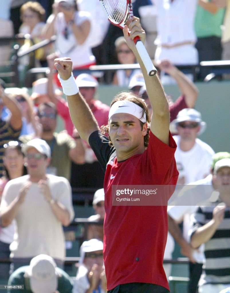 Roger Federer (SUI) claims the Nasdaq-100 Open mens singles title, defeating Rafael Nadal (ESP) 2-6, 6-7 (4), 7-6 (5), 6-3, 6-1.