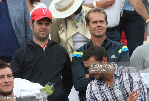 Roger Federer coaches Severin Luthi and Stefan Edberg attend Day 6 of the French Open 2014 held at RolandGarros stadium on May 30 2014 in Paris France