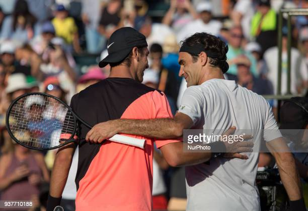 Roger Federer congratulating Thanesi Kokkinakis from Australia after his victory during their second round match at the Miami Open in Key Biscayne on...