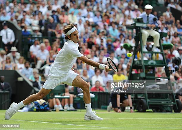 Roger Federer during his Quarter Final match against Stan Wawrinka on Day Nine of the 2014 Wimbledon Tennis Championships at the All England Lawn...